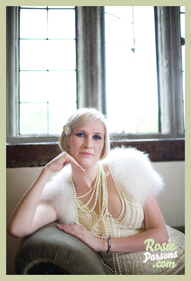 What a stunning bride, ostrich feather shrug, flapper style dress  & miles of pearls....