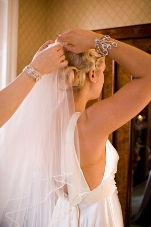 Simply Lovely helping me apply my veil - I loved my hair style!